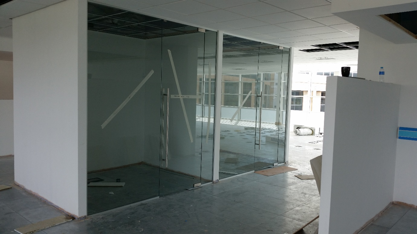 Frameless Glass Partitions with full height doors
