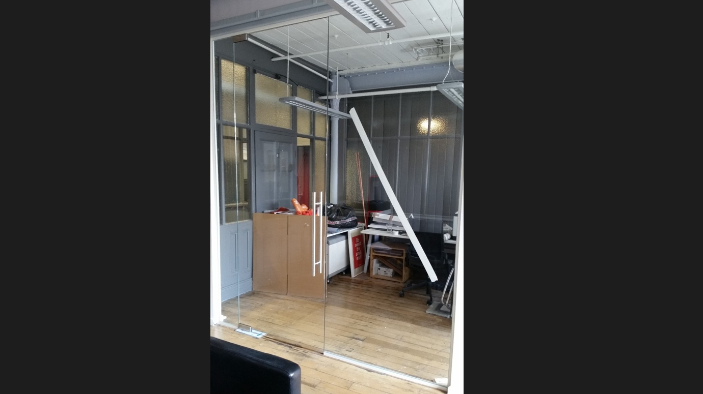 Single Glazed Partition with full height door.
