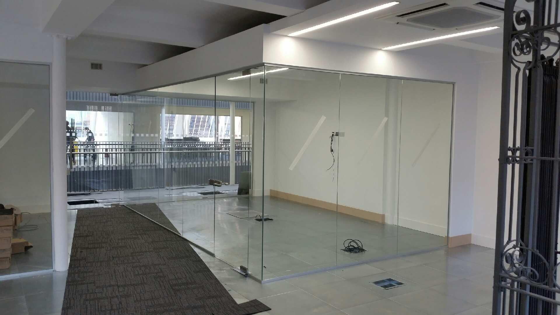 Single Glazed Partition with full height lockable door.